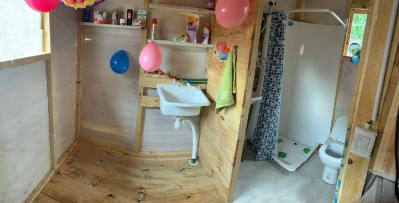 Un baño construido por Módulo Sanitario.